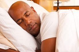 Bald black guy sleeping